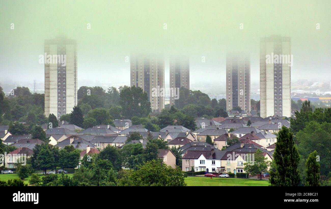 Glasgow, Scotland, UK 23rd July, 2020: UK Weather: Foggy start mist and rain saw low level cloud cap the tops of the Scotstoun towers over the knightswood semi detached as the south of the city disappeared in the mist. Credit: Gerard Ferry/Alamy Live News Stock Photo