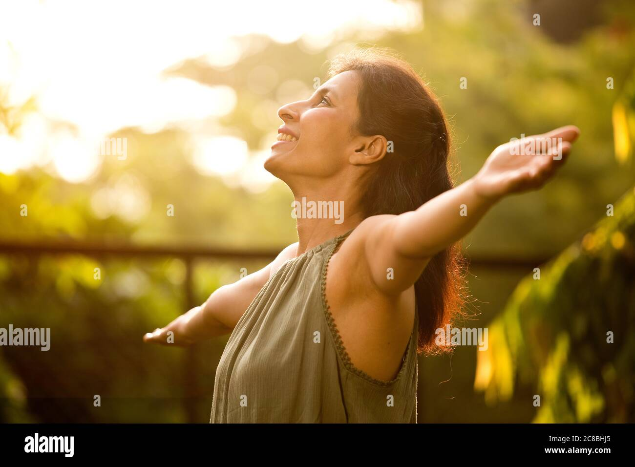 Beautiful woman relaxing and feeling nature at park Stock Photo
