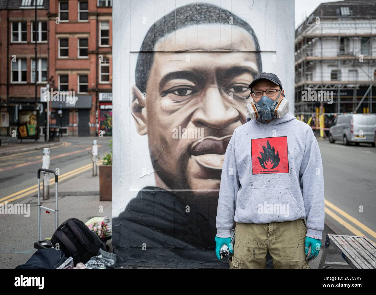 Portrait of Street artist, Akse 19, standing in front of his murals Stock Photo