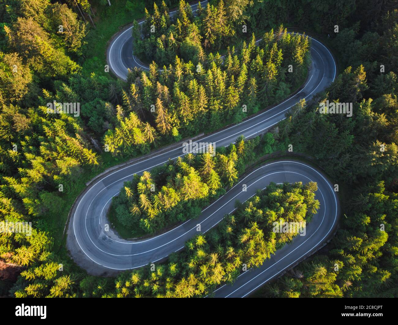 Aerial landscape of mountain winding road, in Transylvania Stock Photo