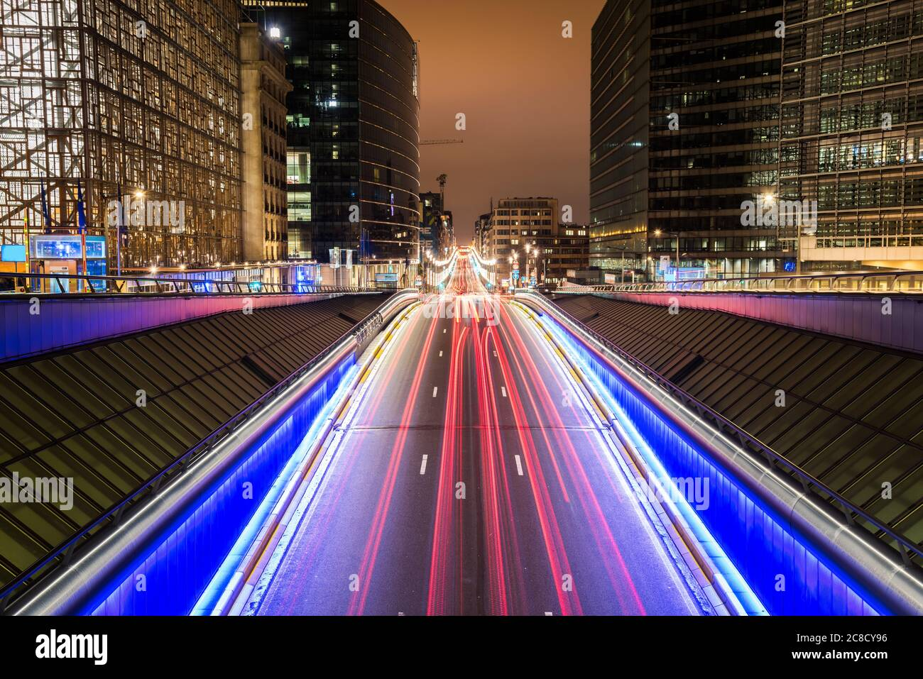 Light trails on a thoroughfare through the European Quarter in Brussels, Belgium, at night. Long exposure. Stock Photo