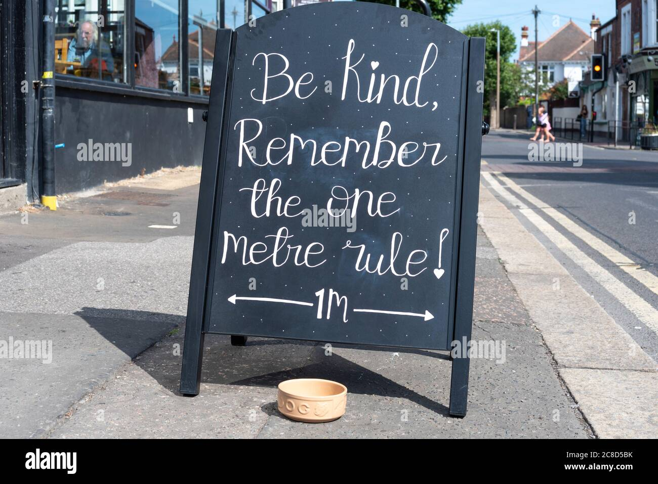 Be kind, remember the one metre rule, chalk blackboard sign outside open restaurant in Westcliff on Sea, Southend Essex, UK. Frank & Lunas coffee shop Stock Photo