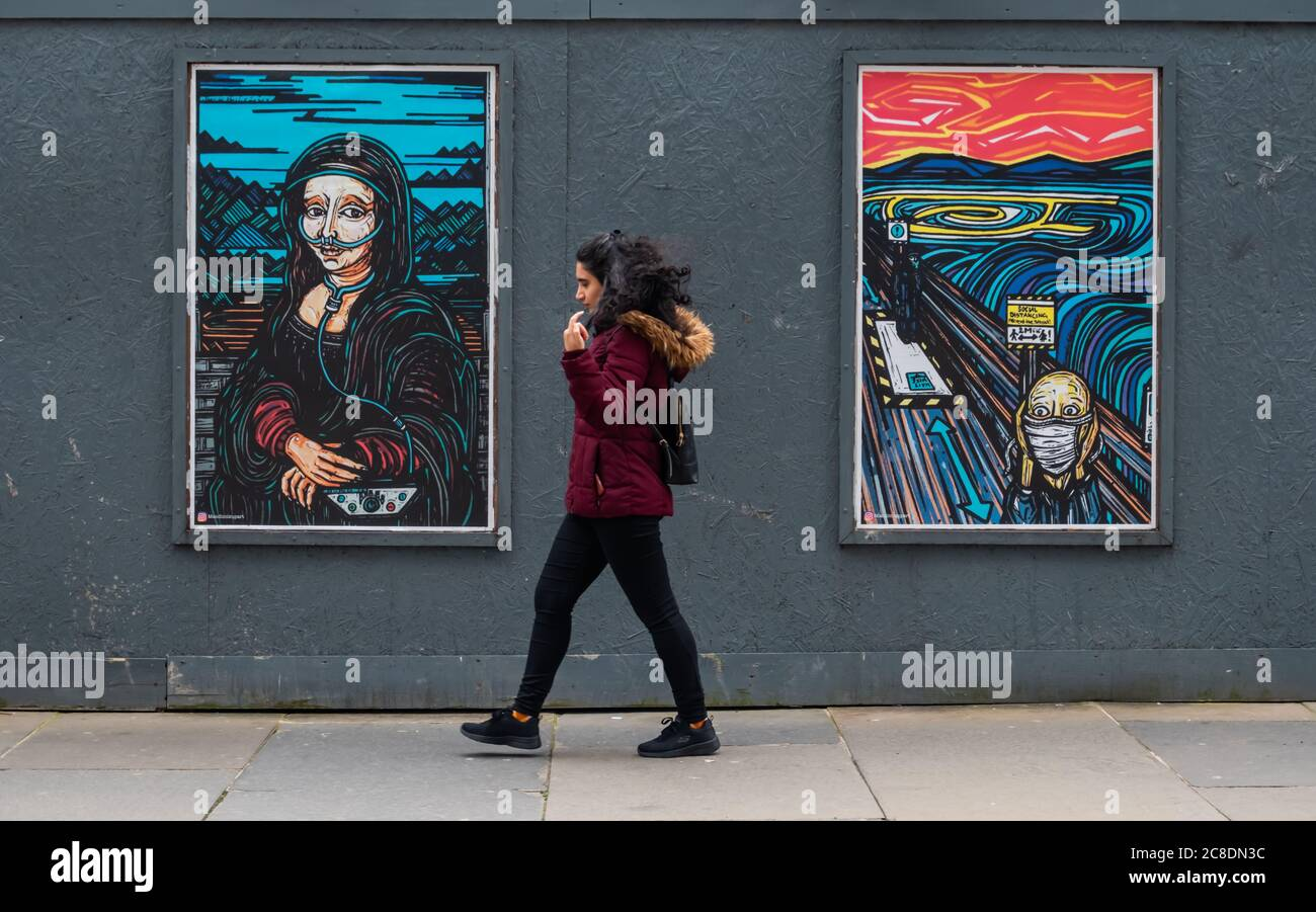 Glasgow, Scotland, UK. 23rd July, 2020. Covid collection posters showing artwork by Mandi Mix Up. From left they are entitled Corona Lisa and Scream Here. Credit: Skully/Alamy Live News Stock Photo