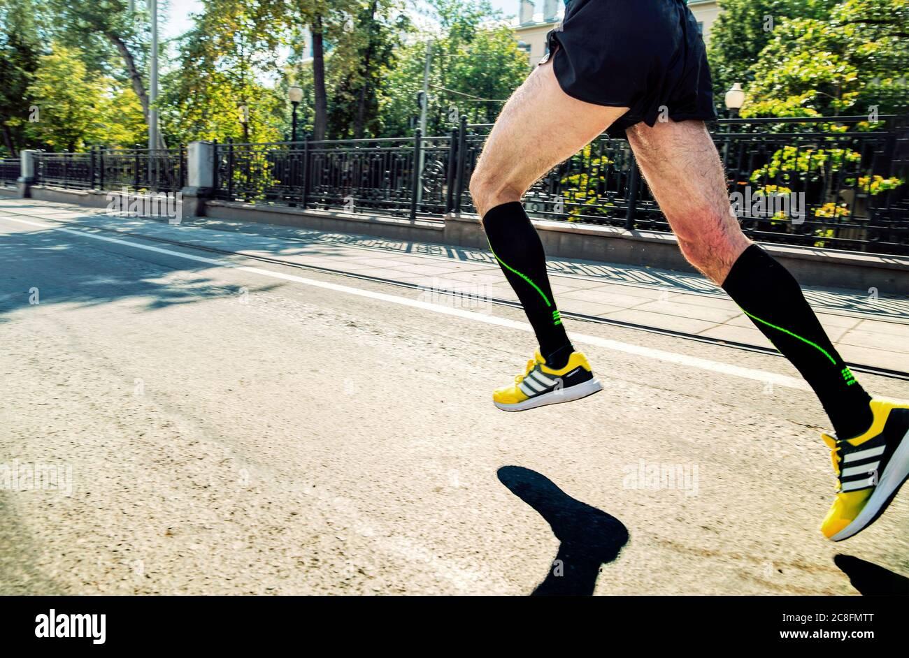 Ekaterinburg, Russia - August 7, 2016: legs man athlete runner in ...