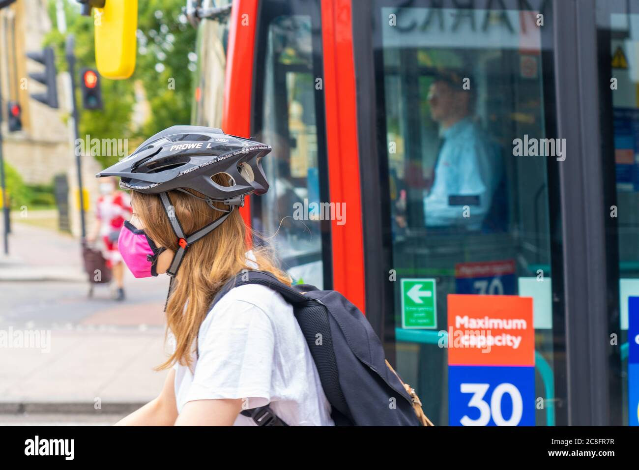 London Uk Friday 24 July 2020 A Cyclist Wearing A Protective Mask In Ealing On The