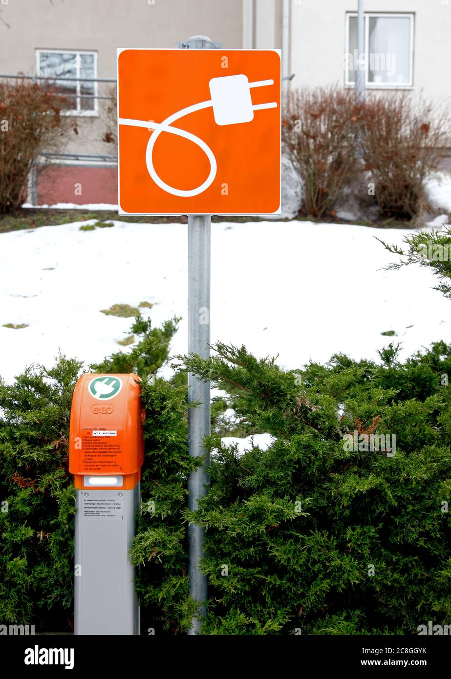 Charging pole, for electric car, at a parking lot. Photo Jeppe Gustafsson Stock Photo