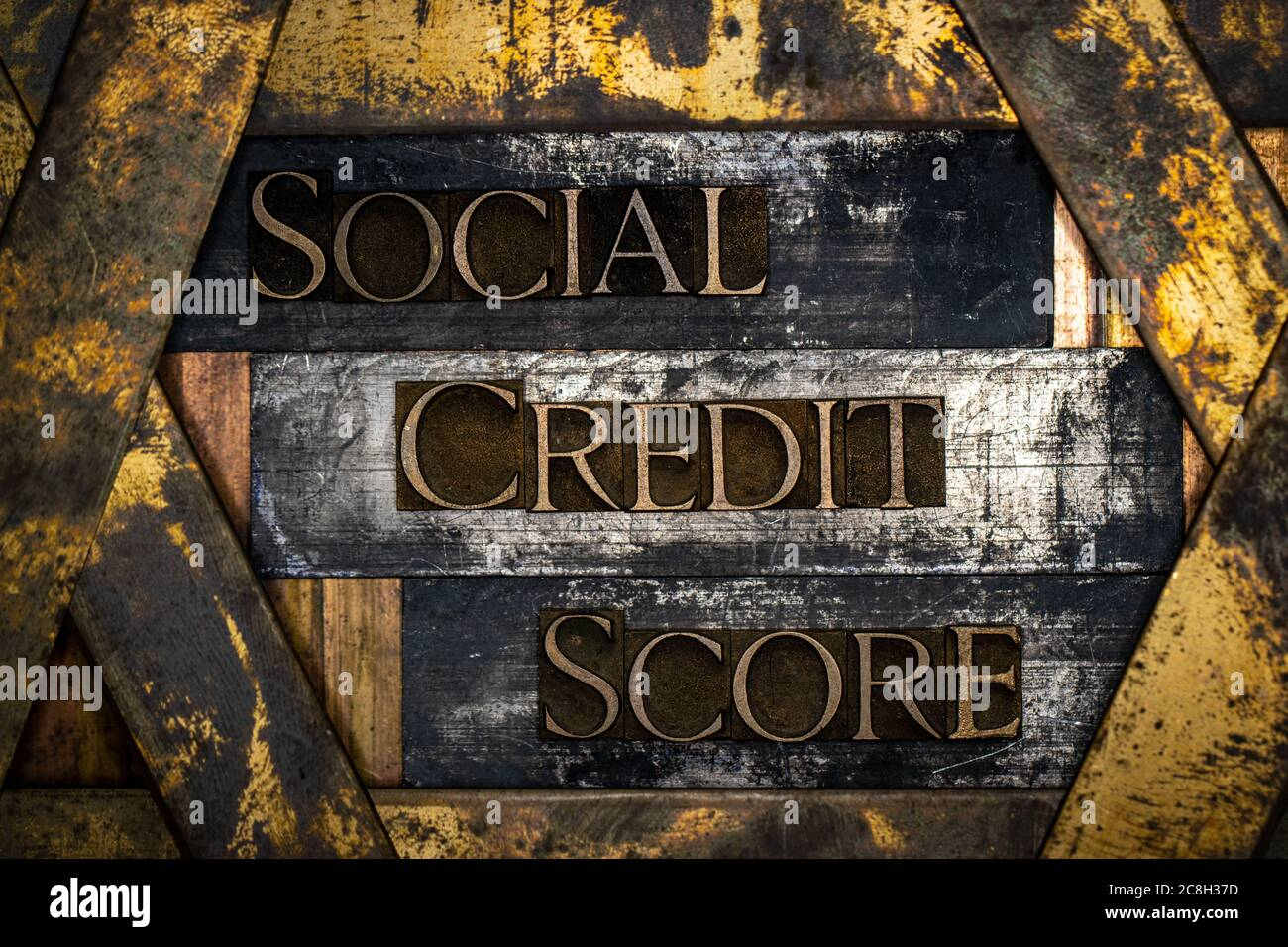 Social Credit Score text formed with real authentic typeset letters on vintage textured silver grunge copper and gold background Stock Photo