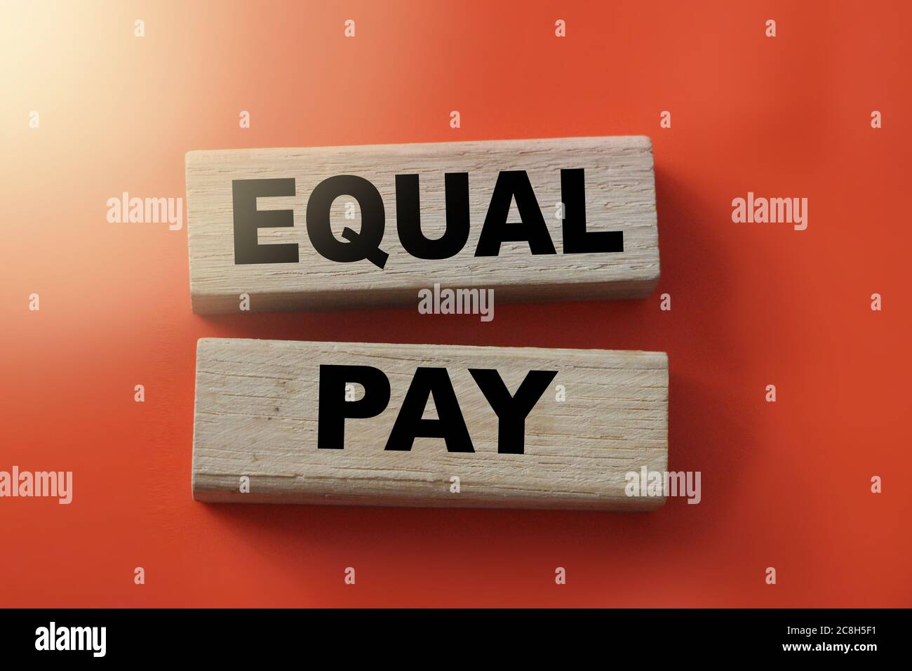 Equal pay words on wooden blocks. No Income differences concept Stock Photo