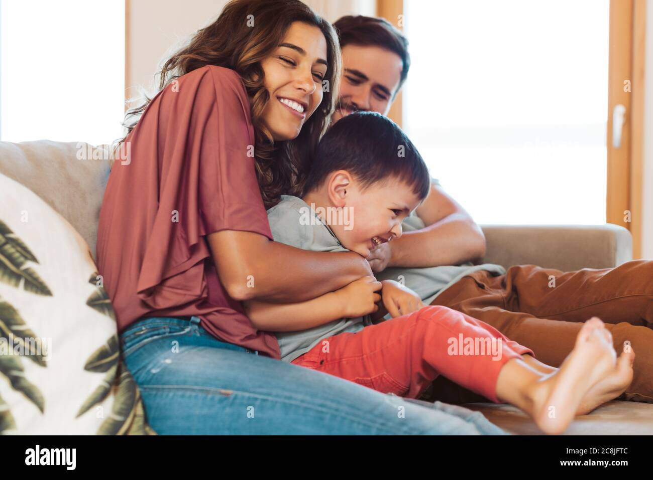 Young family having fun at home Stock Photo