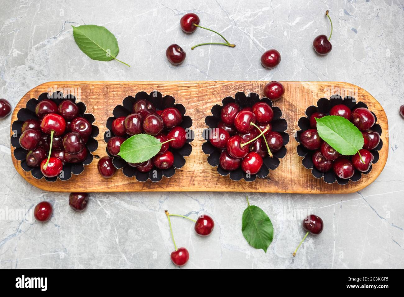 Flat lay composition with sweet cherries on marble table, space for text. Stock Photo