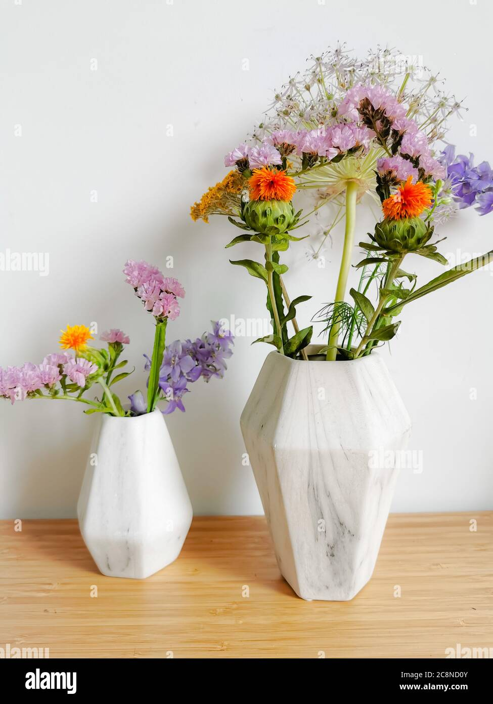 Small Bouquet Of Wild Spring Flowers In Faux Marble Vases Stock Photo Alamy