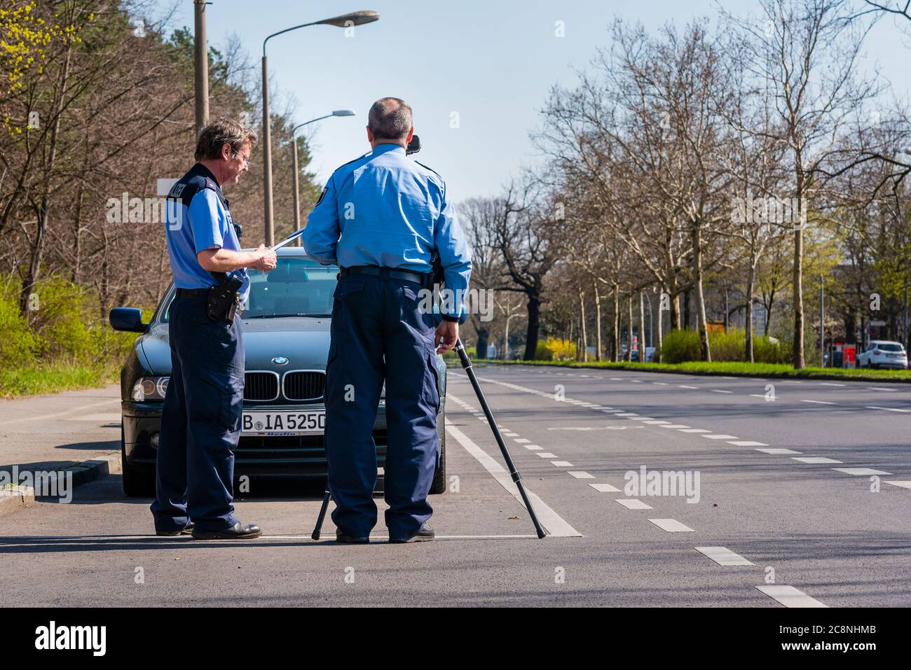 Police officers control the speed with a laser gun, speed control, two police officers do a speed control Stock Photo
