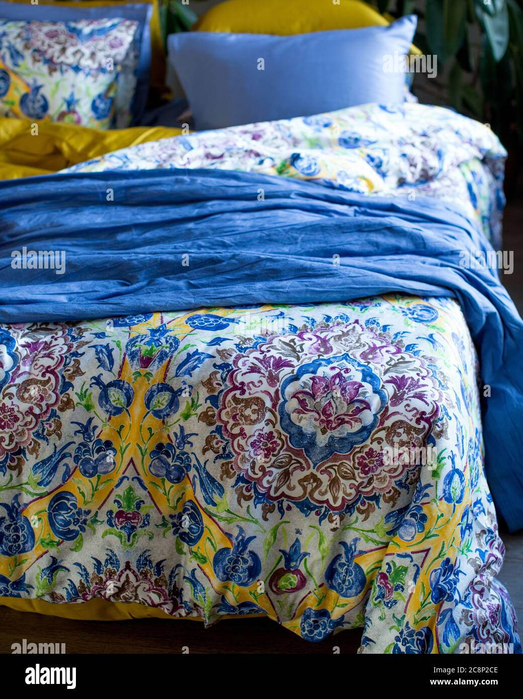 Picture of: A Vertical Shot Of The Beautiful Bedsheets With Traditional Patterns In A Bedroom Stock Photo Alamy