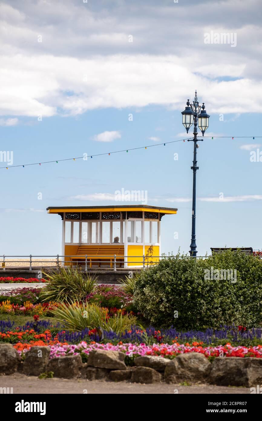 Yellow Bus Shelter Bench, Southsea esplanade, Portsmouth, Hampshire, United Kingdom Stock Photo