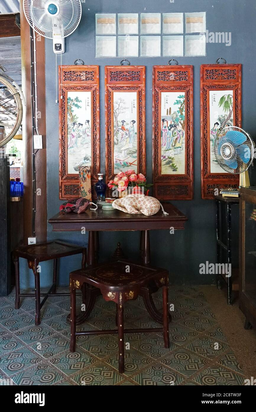 Interior design and decoration of southern Thai restaurant and cuisine decorated with wooden traditional Chinese furniture and wall paintings Stock Photo