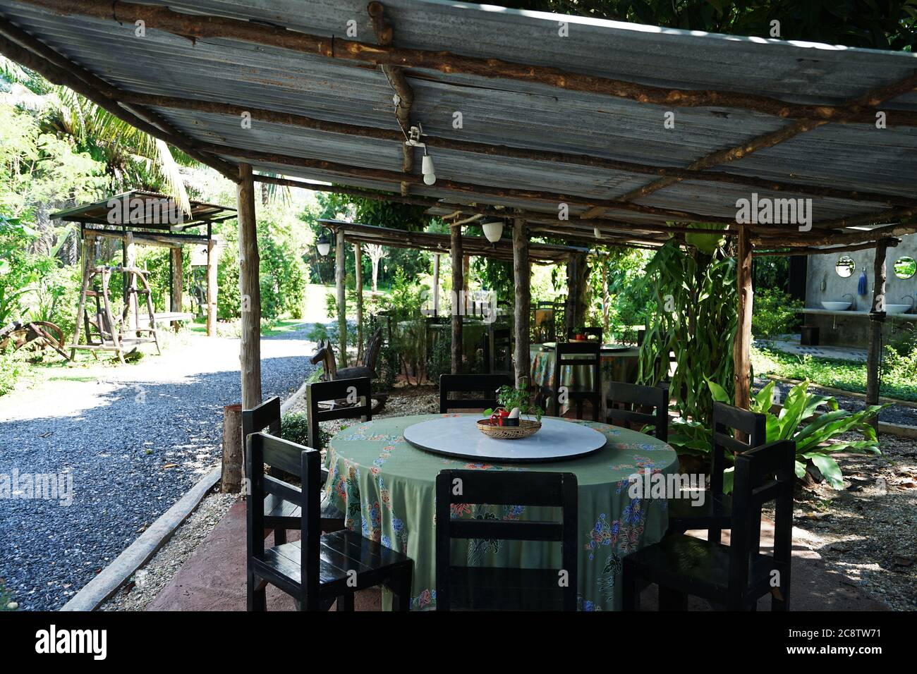 Exterior Design And Restaurant Decoration Of Outdoor Dining Seats Decorated With Wooden Vintage Furniture In Green Garden Park Stock Photo Alamy