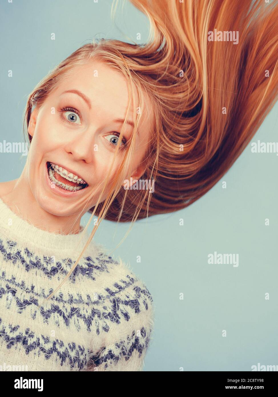 Hairstyles Ideas Happiness Concept Crazy Teenage Woman Wearing Winter Jumper With Windblown Blonde Hair Stock Photo Alamy