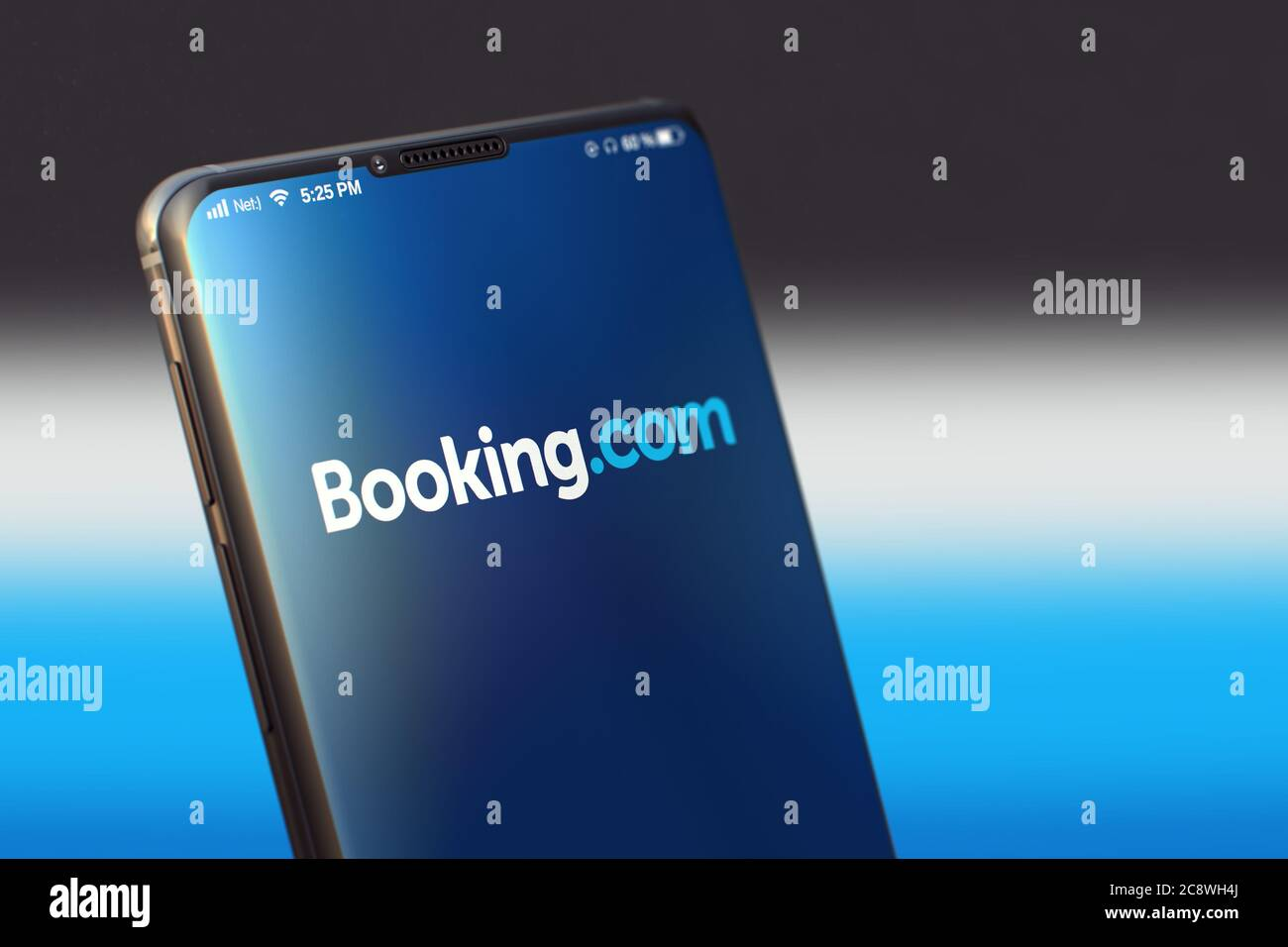 KYIV, UKRAINE-JUNE, 2020: Booking Mobile Application on the Smartphone Screen. Close UpStudio Shot of Smartphone with Booking Application. Stock Photo