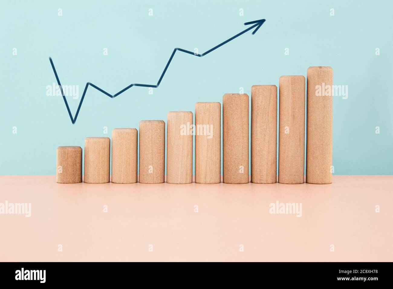 Business growth concept on blue background. Wood block increasing chart. Stock Photo
