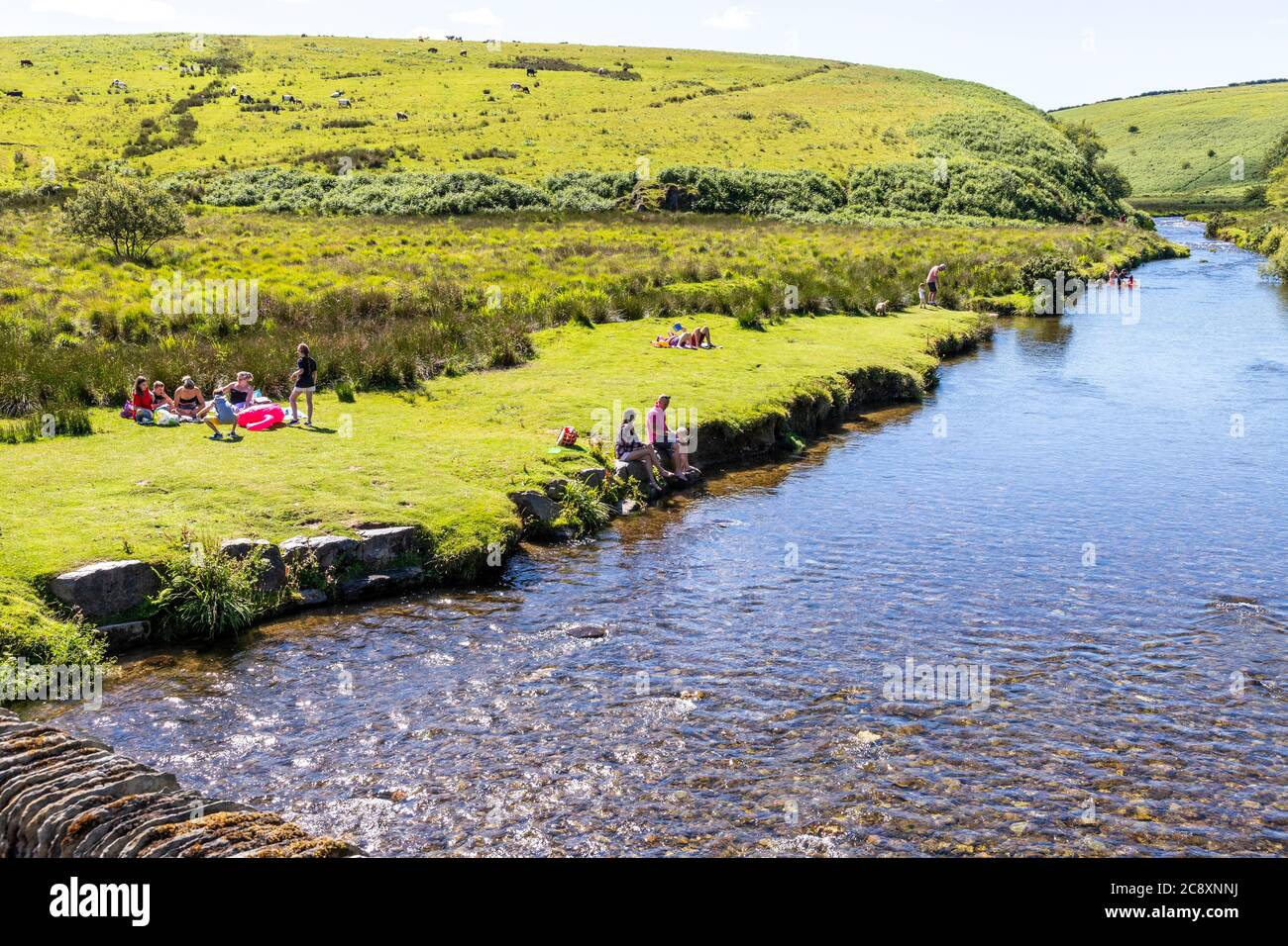 A sunny Saturday summer afternoon on Exmoor National Park beside the River Barle at Landacre Bridge near Withypool, Somerset UK Stock Photo