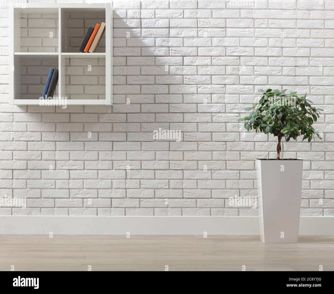 Room Interior With A White Brick Wall A Plant And Shelves With Books Stock Photo Alamy