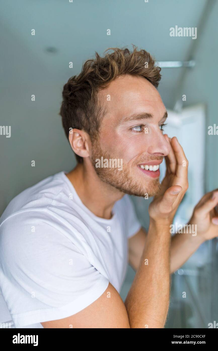 Man Putting Under Eye Cream On Face Taking Care Of His Skin Anti