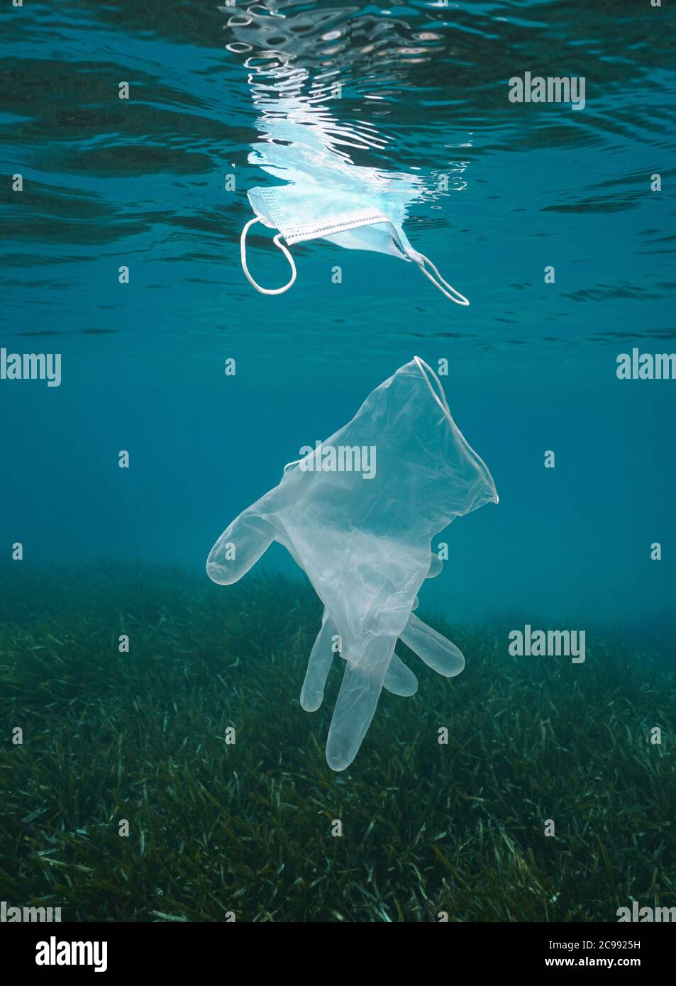 Plastic waste pollution underwater in the sea, glove and face mask, coronavirus COVID-19 pandemic, Mediterranean sea Stock Photo
