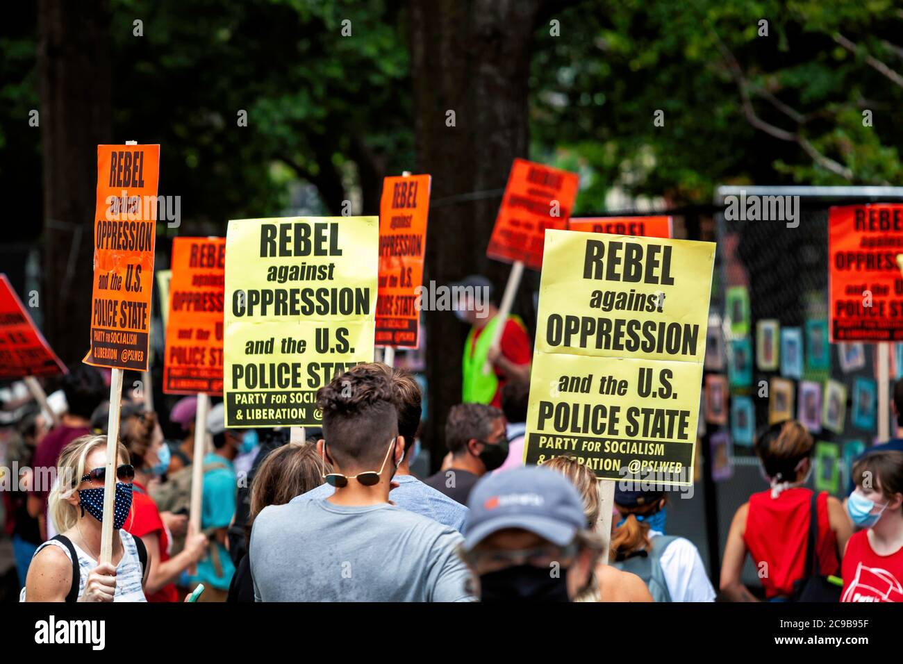 Protesters with signs at Lafayette Square / White House before March Against Trump's Police State, Washington, DC, United States Stock Photo