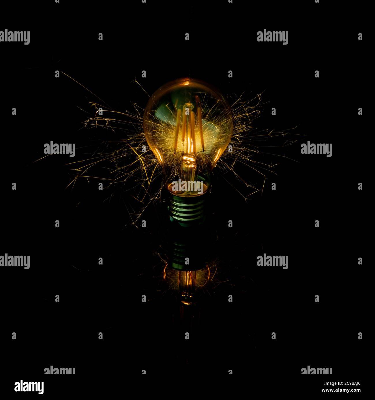 Light Globe Moment with Sparkler Stock Photo