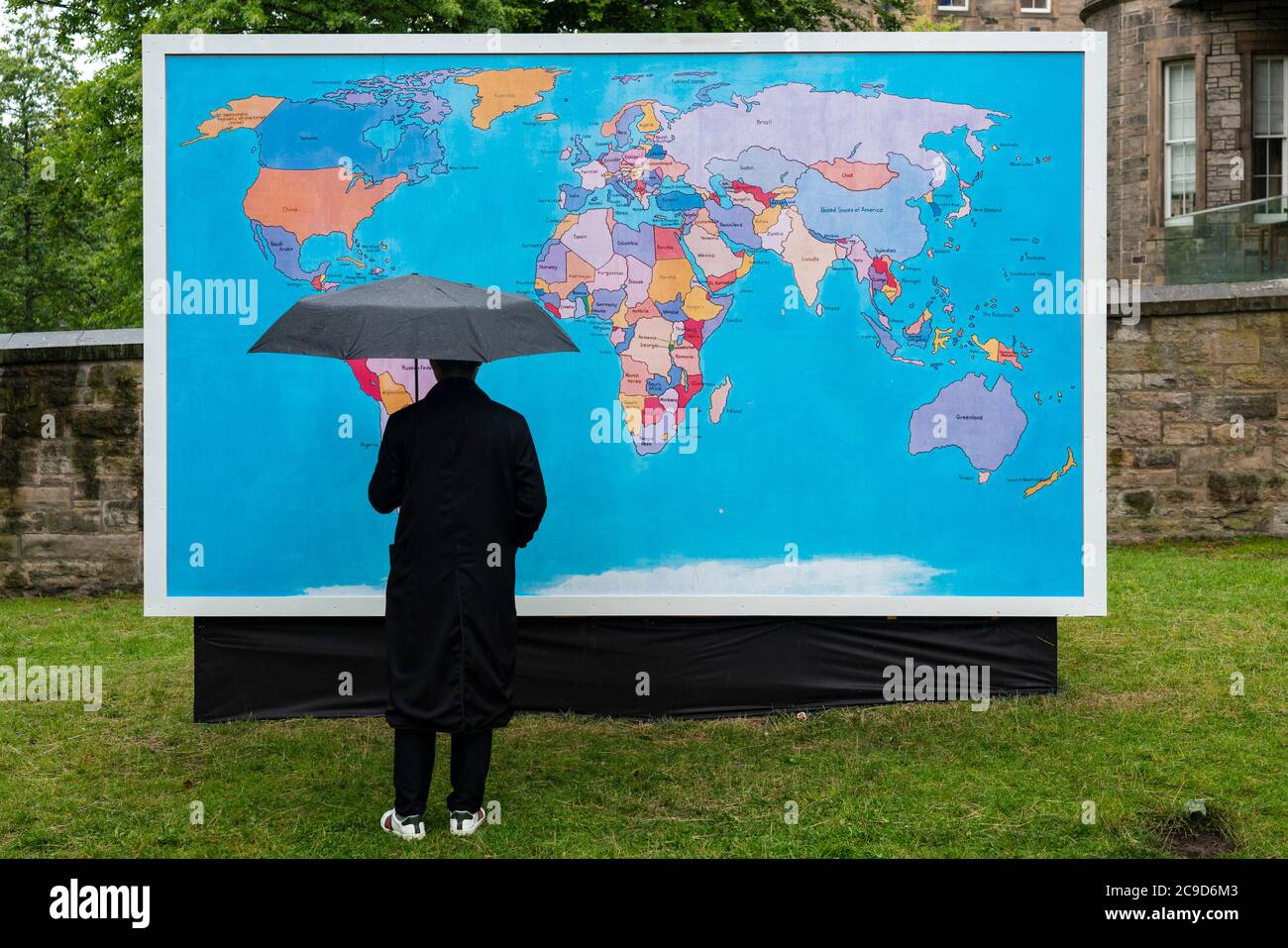 Edinburgh, Scotland, UK. 30 July, 2020. Because this years Edinburgh Art Festival has been cancelled due to the Covid-19 pandemic, the organisers invited 10 artists from previous festivals, to work with them to mark the dates of what would have been their 2020 festival. Pictured; Tam Joseph's work The Hand Made Map Of The World, (2014) in which the countries of the world have been playfully changed, is on display at The Meadows. The map is based on an original painting made in 2012 and was first presented as a billboard in the 2014 festival. Iain Masterton/Alamy Live News Stock Photo