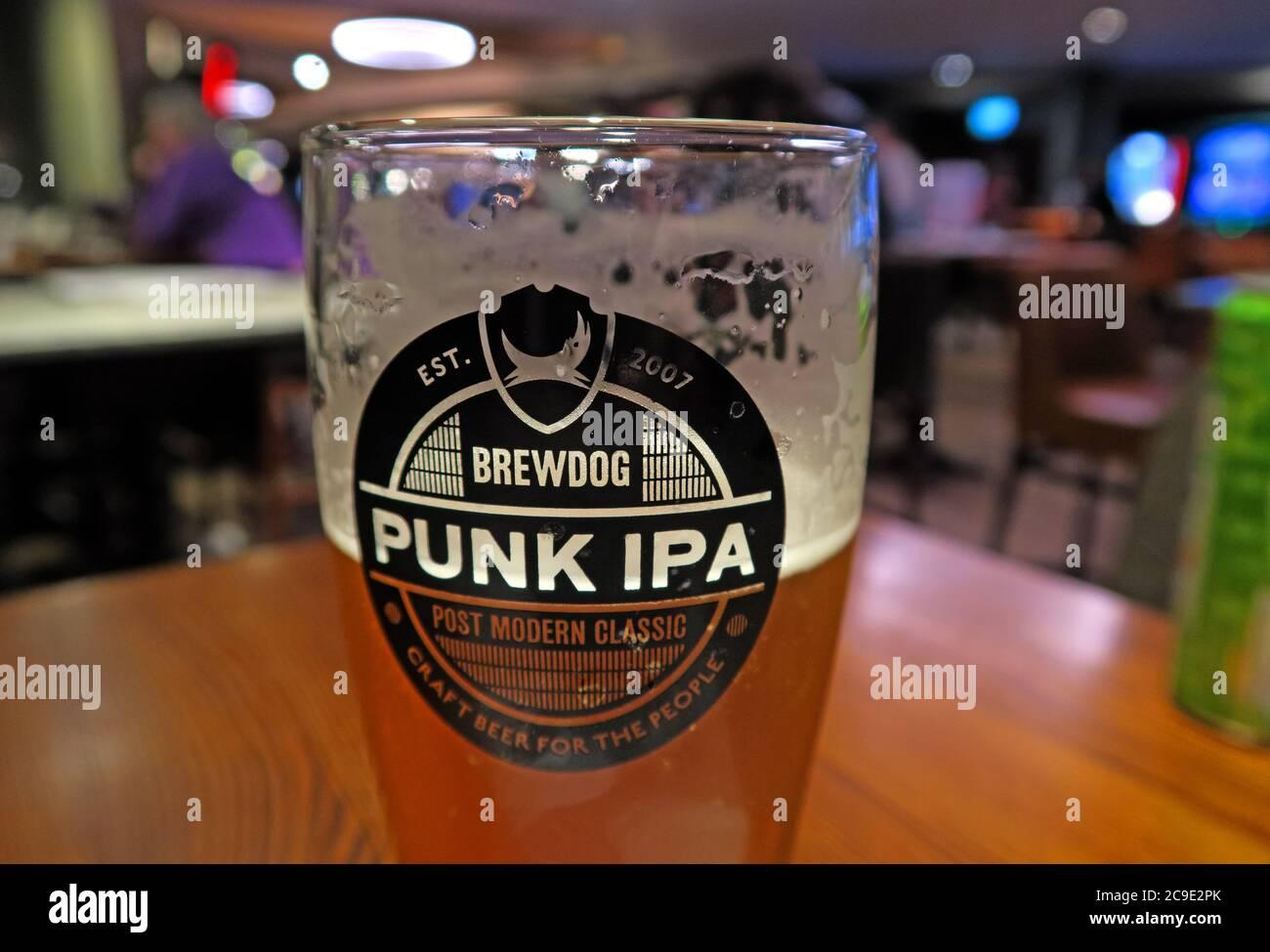 Brewdog Glass , Punk IPA glass, Wetherspoon Pub,cheap ale,cheap pint,Brewdog Brewing - glass half full Stock Photo