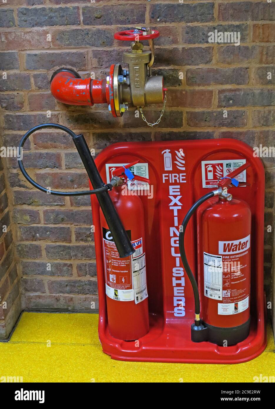 Fire hydrant tap and Fire Extinguishers station, in a public building,England,UK - water Stock Photo