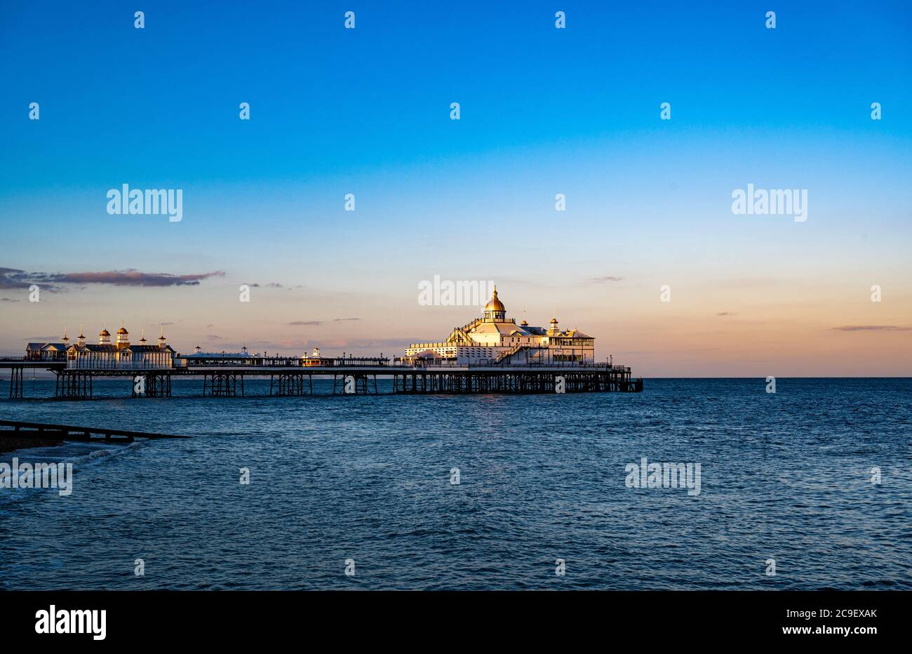 Eastbourne Pier seen from the Beach at Sunset Stock Photo