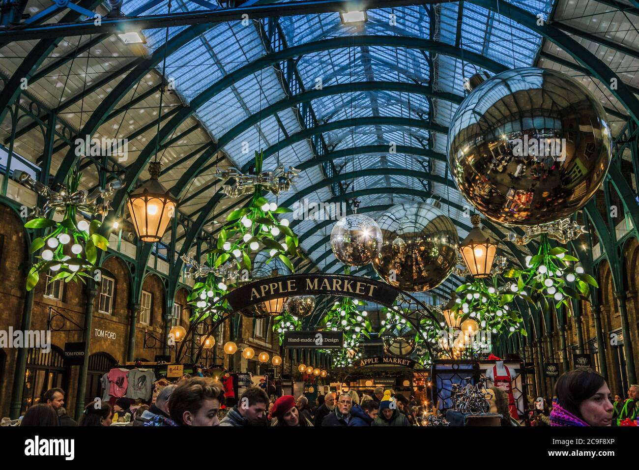 Covent Garden, London Apple Market decorated for Christmas with shoppers in the foreground Stock Photo