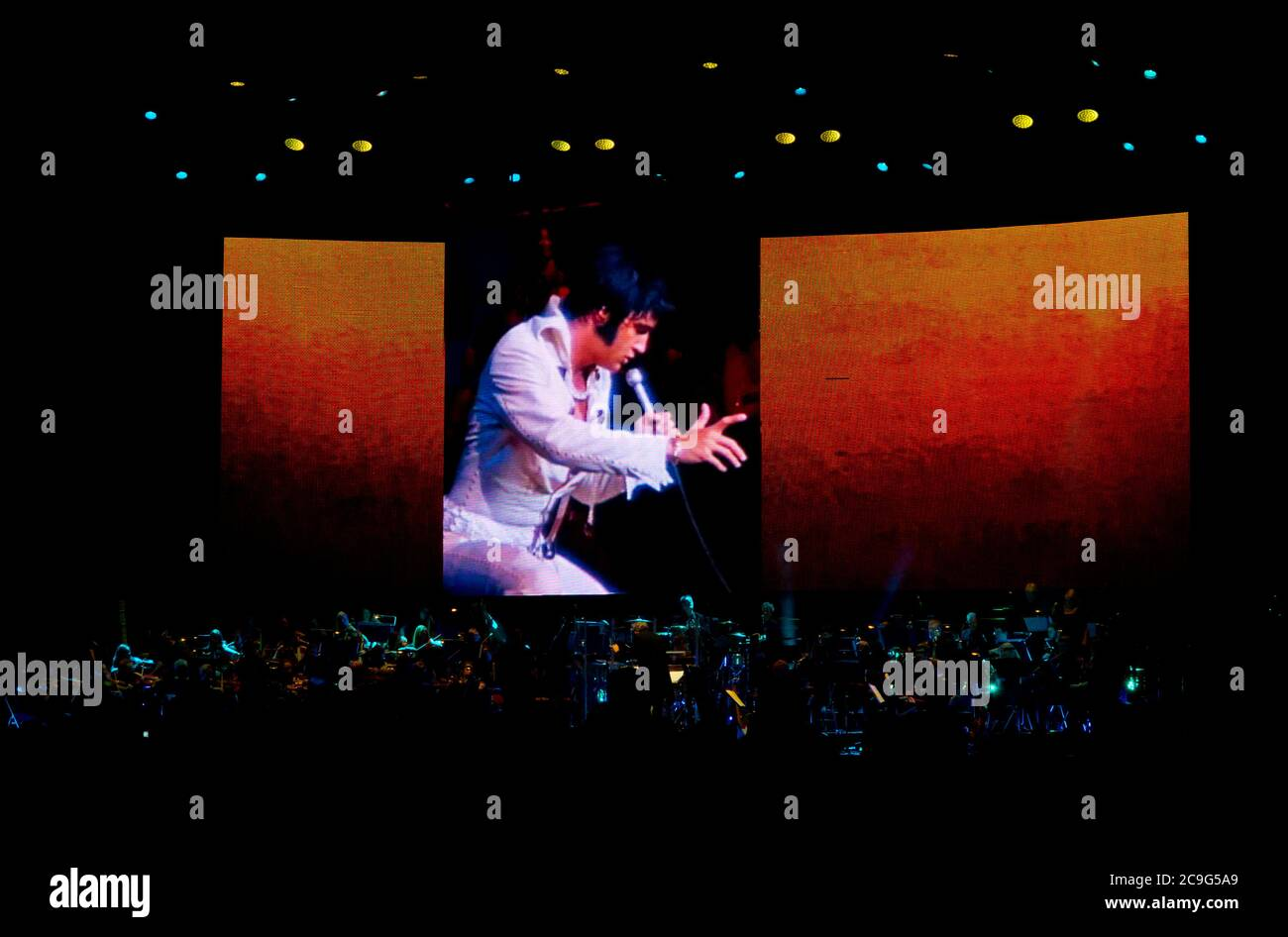 Elvis Presley In Concert Live on Screen with the Royal Philharmonic Orchestra 2016 a concert tour with video footage of Elvis with a live orchestra. Stock Photo