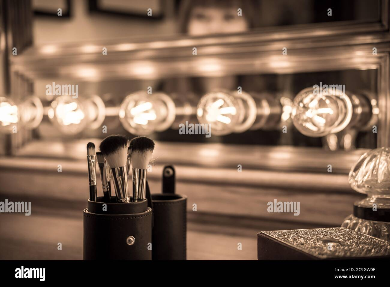 Vintage Vanity Makeup Accessories Makeup Dressing Table With Undefined Woman At Mirror Stock Photo Alamy