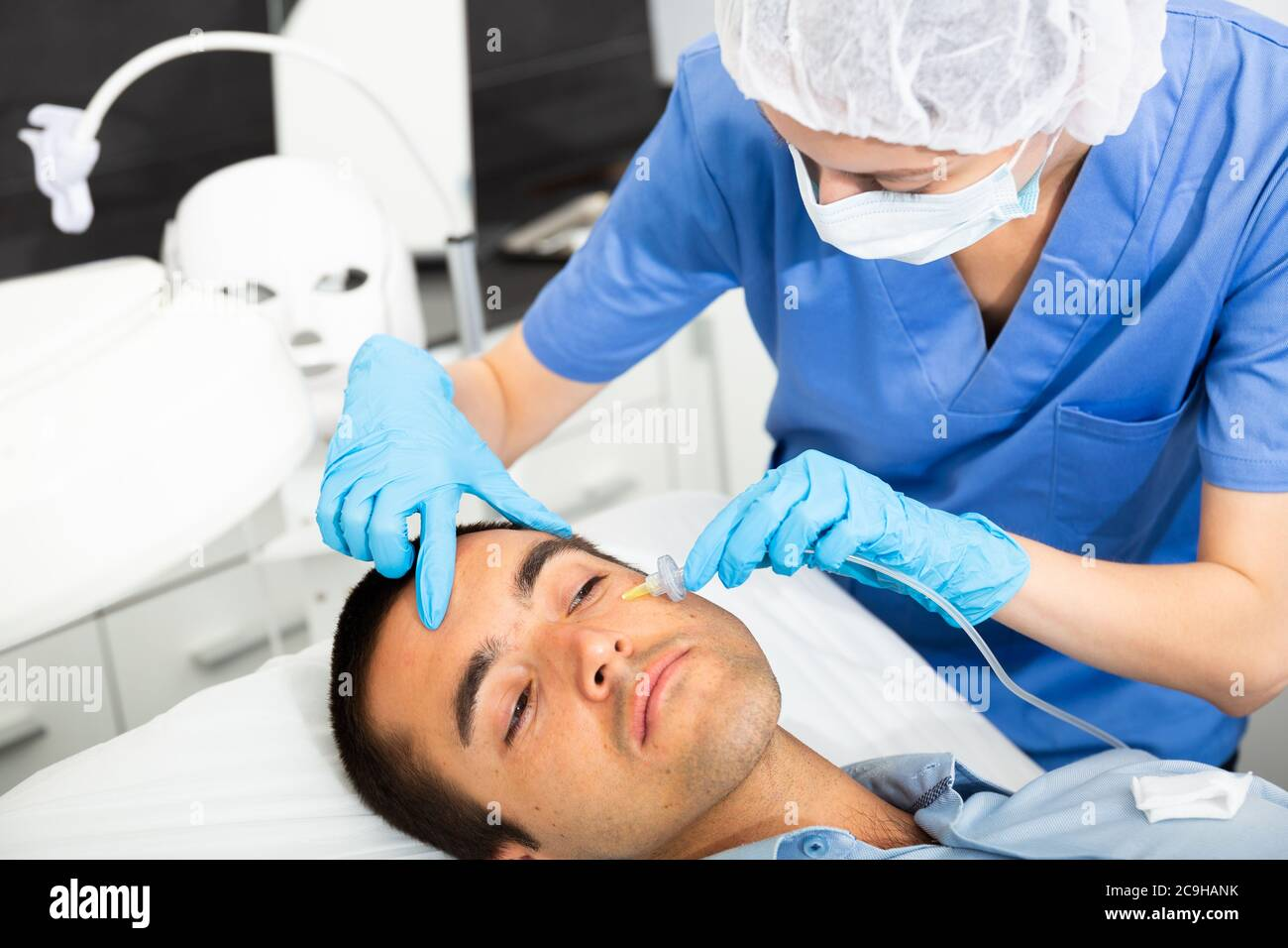 Portrait Of Young Client Of Aesthetic Medicine Clinic During Carboxy Therapy Doctor Injecting Carbon Dioxide Under Face Skin To Increase Blood Flow I Stock Photo Alamy