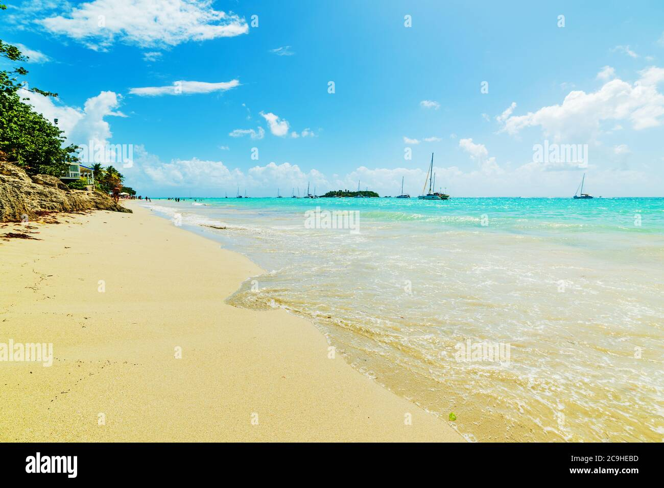White sand and turquoise water in La Datcha beach in Guadeloupe, French west indies. Lesser Antilles, Caribbean sea Stock Photo