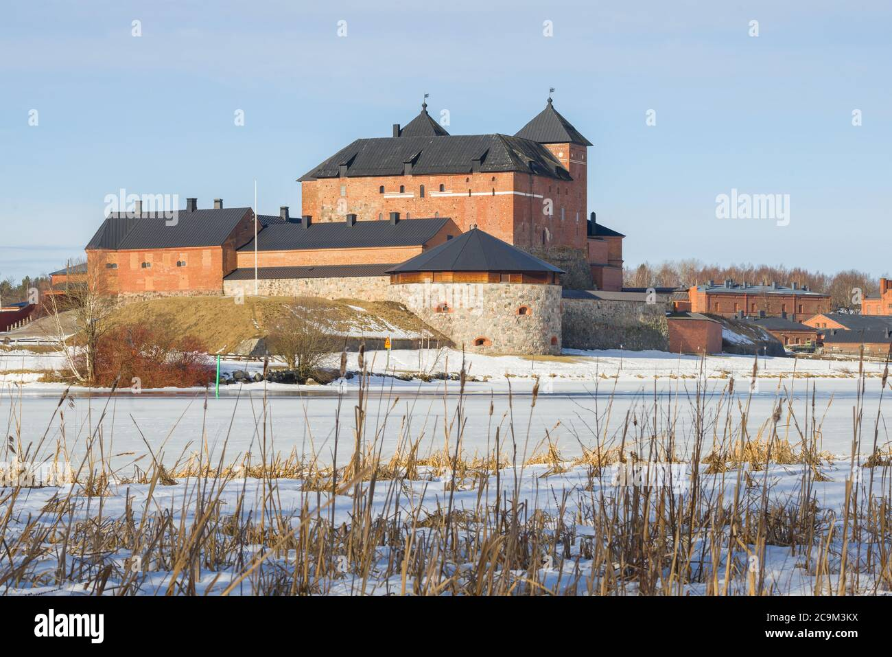 View of the ancient Hameenlinna fortress from the shore of Vanajavesi lake on a sunny March day. Finland Stock Photo