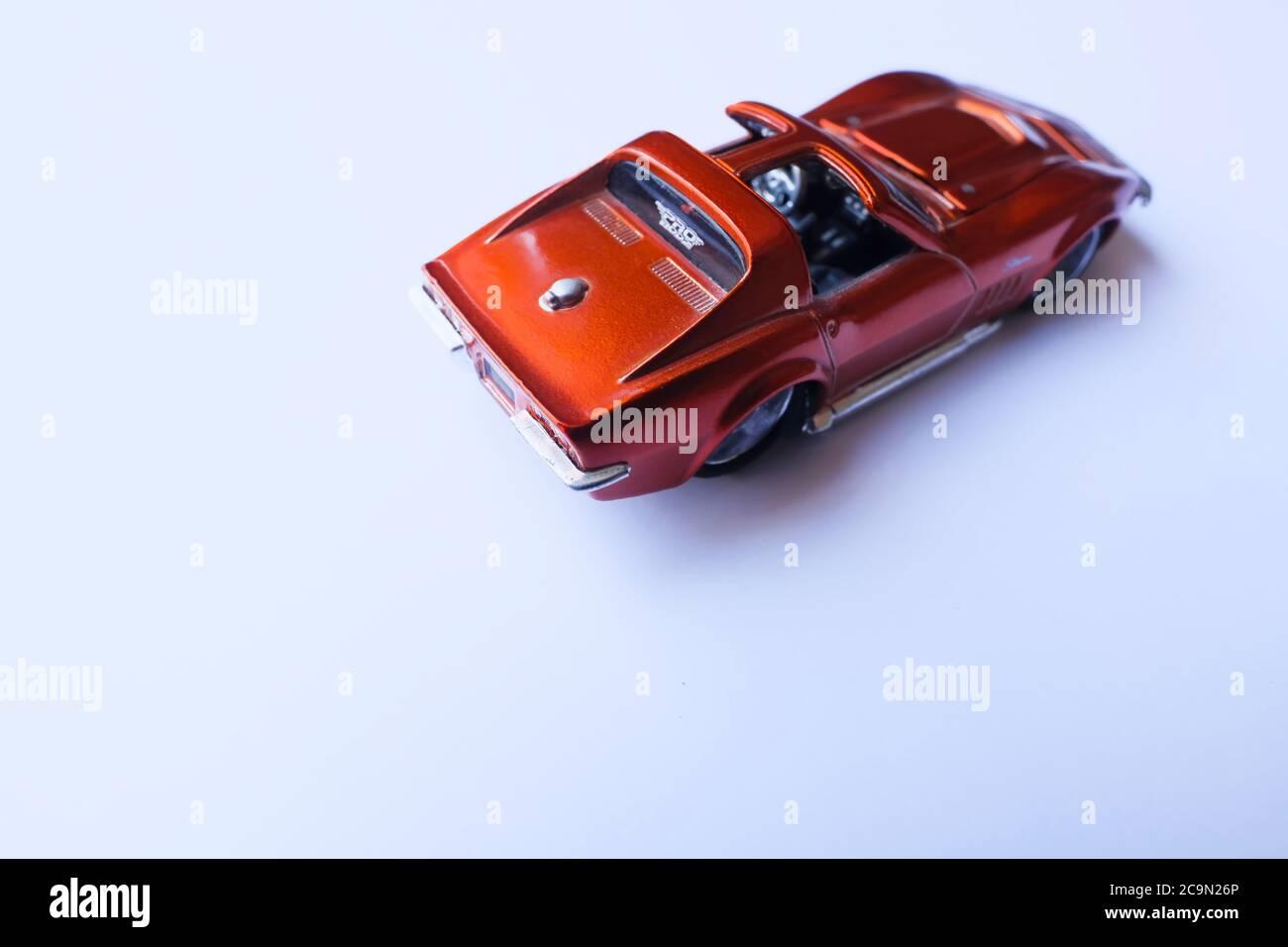 Istanbul, Turkey - July 29, 2020 : Maisto pro rodz 1 64 scale orange 1969 Corvette Stingray die cast toy car on white background from rear view. Stock Photo