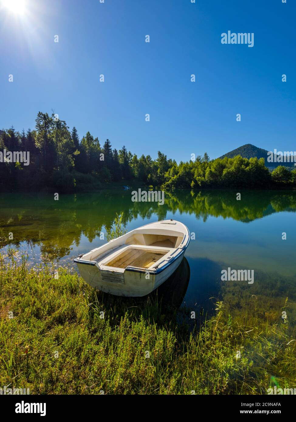 Lonely boat moored beautiful nature of Lokve lake in Croatia Europe Stock Photo