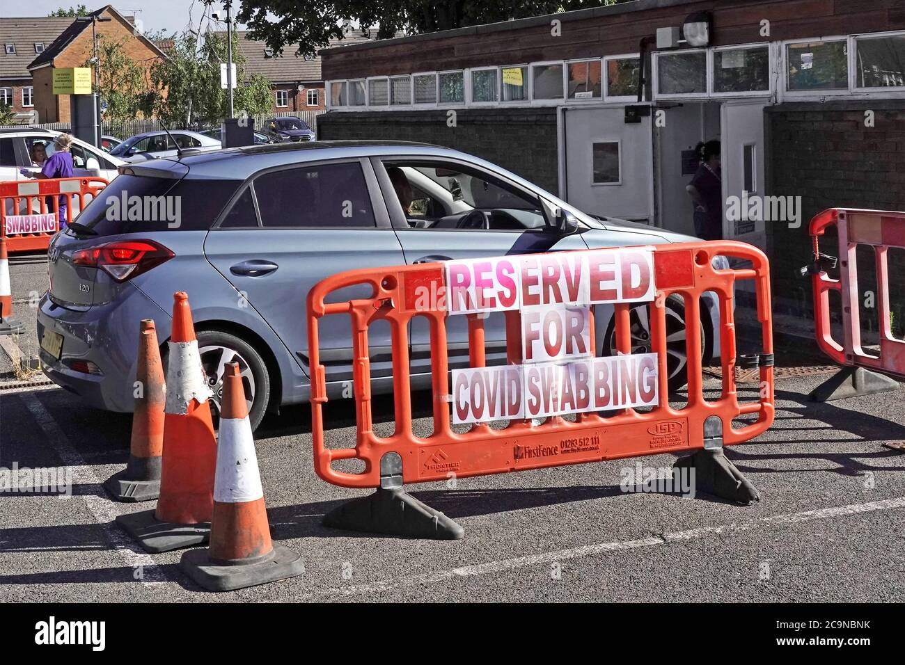 Orsett NHS Hospital makeshift car parking spaces reserved for Covid 19 drive in patients for swab test in car park for coronavirus Essex England UK Stock Photo