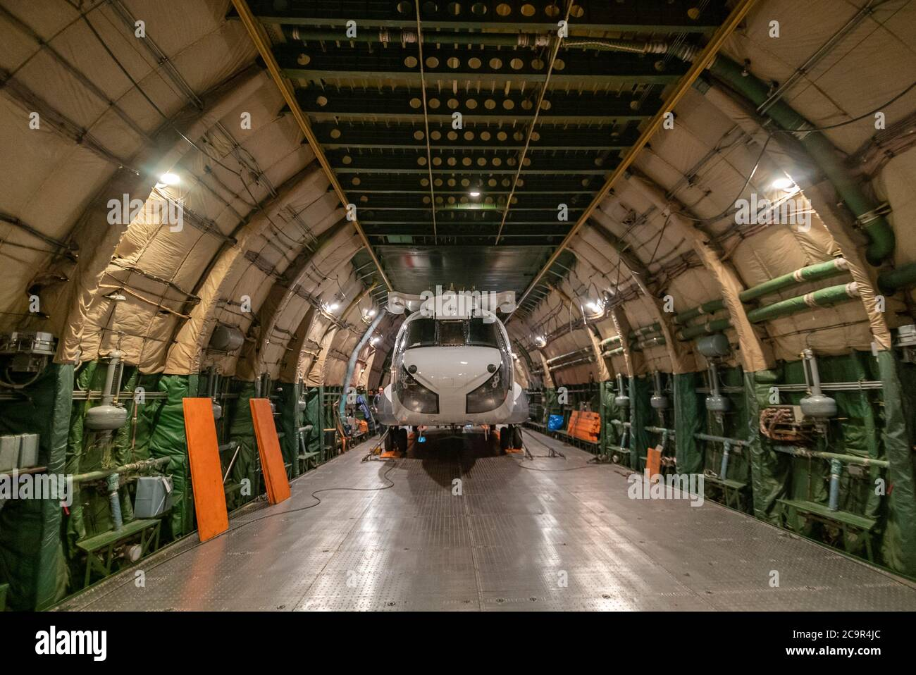 Chinook Helicopter inside the Antonov Cargo airplane heading to Bolivia to fight fires in amazon Stock Photo
