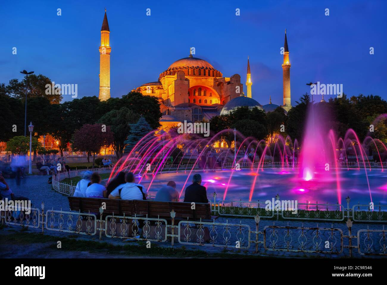 City of Istanbul in Turkey by night, people enjoy the view of Hagia Sophia (Ayasofya) and fountain in Sultanahmet Park Stock Photo