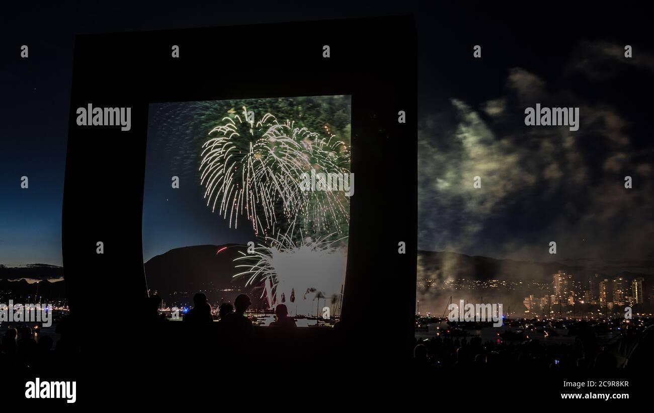 Nighttime long exposure fireworks in Kitsilano Beach Vancouver, BC, Canada Stock Photo