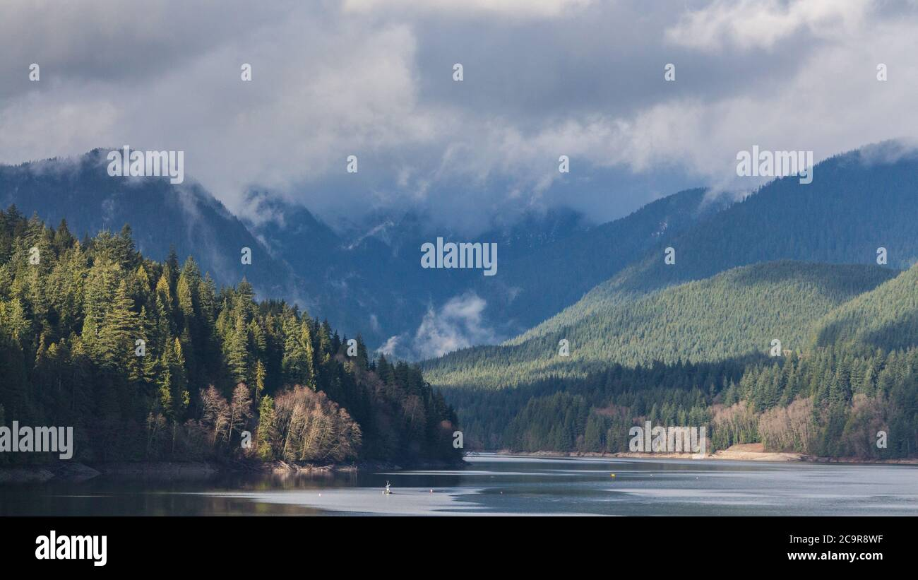 A scenic View of Cleveland Dam reservoir surrounded by mountains, North Vancouver, Canada Stock Photo
