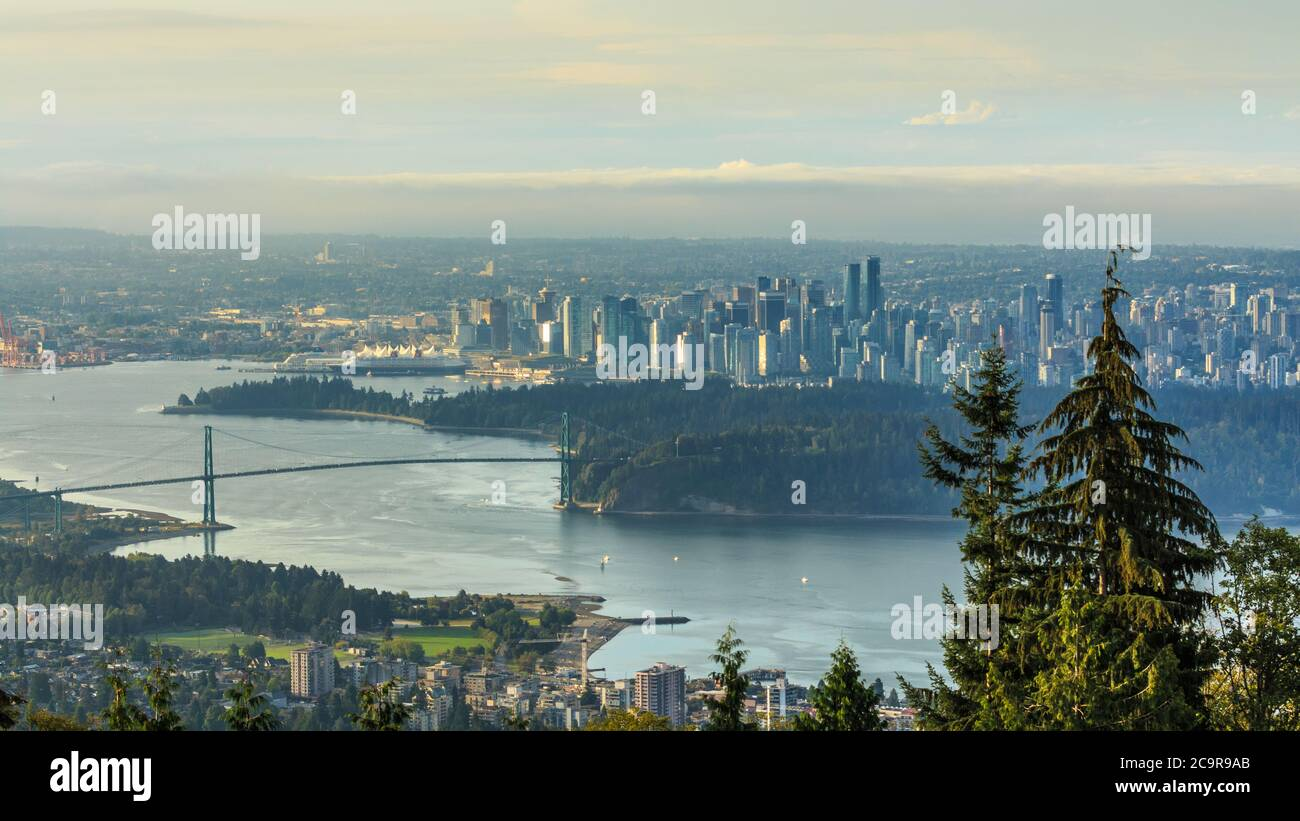Aerial view of the city of Vancouver looking at the Lions gate bridge and downtown Vancouver during sunrise from the Cypress mountain Viewpoint Stock Photo
