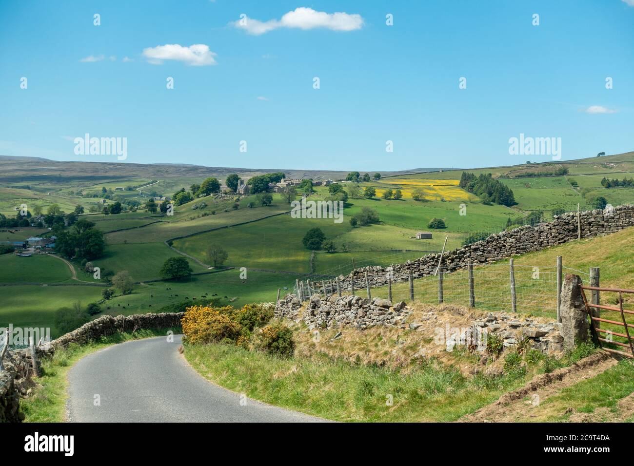 Looking down Trapping Hill in Nidderdale and across to the village of Middlesmoor, North Yorkshire, England, uk Stock Photo