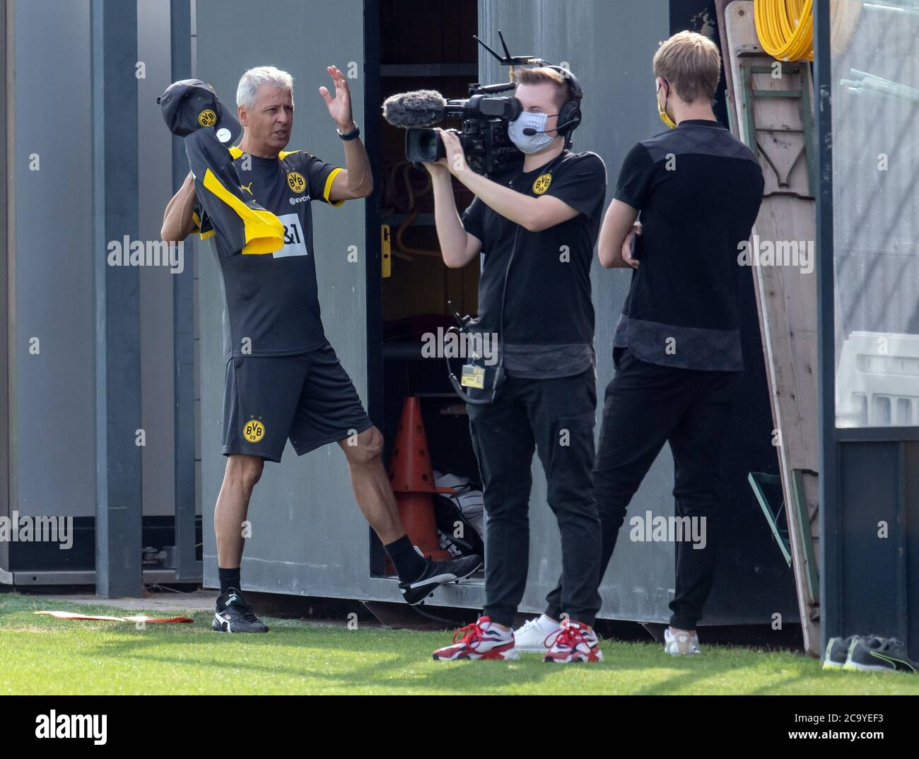 Dortmund Germany 03rd Aug 2020 Coach Lucien Favre L Coach Of Borussia Dortmund Is Standing Next To A Team From The Club S Own Broadcaster On The Training Ground Credit Bernd Thissen Dpa