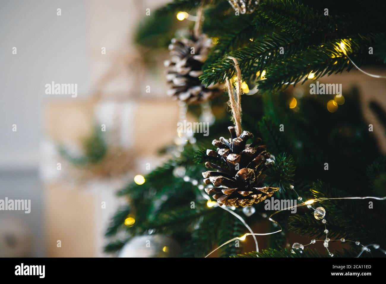 Close Up Of Christmas Tree With Yellow Christmas Lights Toys And Cones Xmas And New Year Concept Stock Photo Alamy